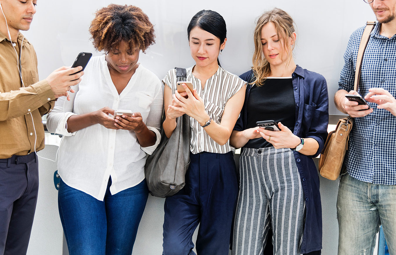 employees using mobile device for e-learning