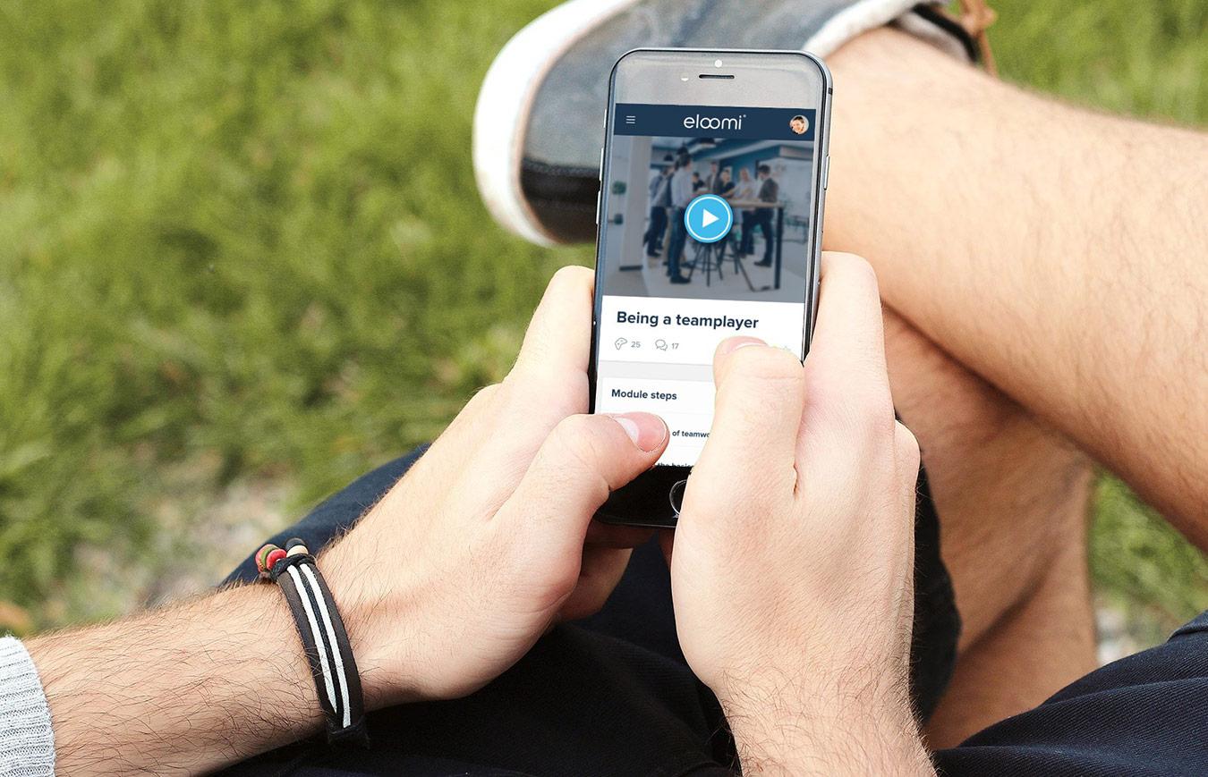 man using mobile phone to take e-learning module