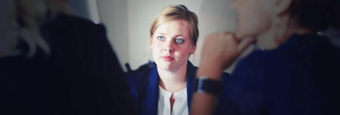Blonde female employee receiving feedback