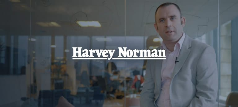 Harvey Norman logo, eloomi customer using LMS and performance solution from eloomi