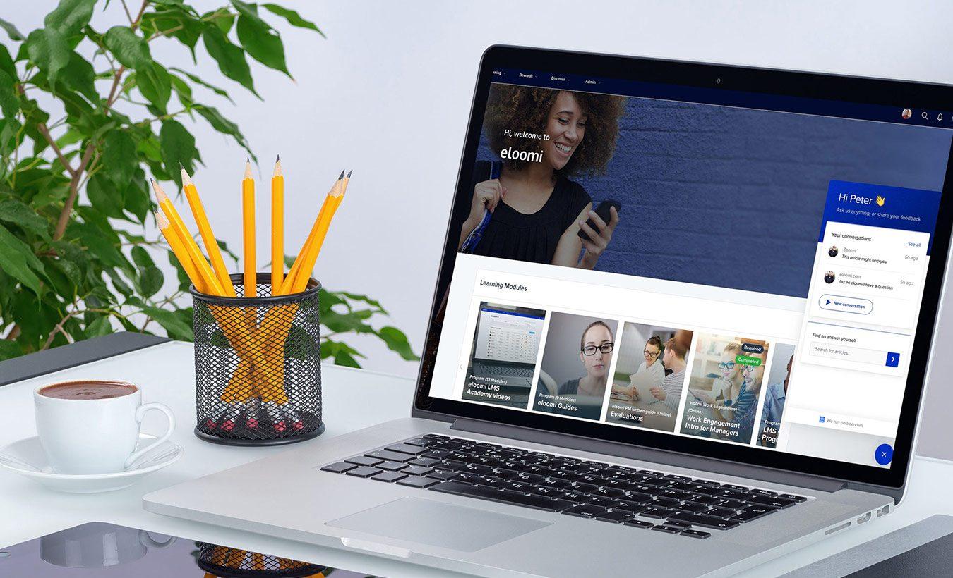 Laptop on the desktop displaying eloomi insights